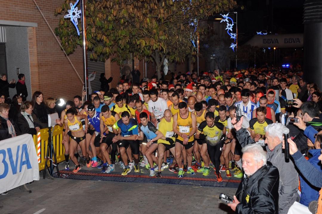 Uns 760 corredors acomiaden l'any fent la 18a cursa Sant Silvestre |FOTOS|