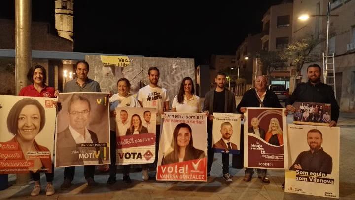 L'enganxada de cartells reuneix als candidats en l'arrancada de la campanya electoral | FOTOS